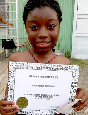 camper with her completion certificate