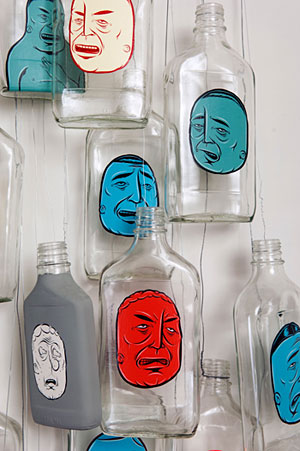 Street characters painted on bottles, by Barry McGee