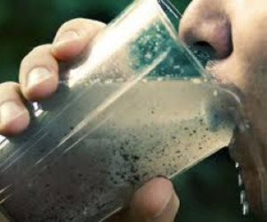 Person drinking dirty water