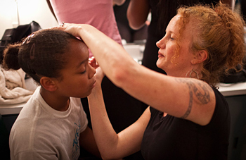 Amy Cranch helps young dancer with makeup