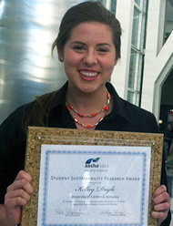 student holding award for sustainability thesis