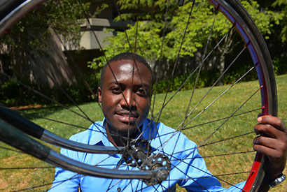 Ugandan AIDS orphan discovers power of the pedal